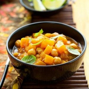 Pumpkin curry with chickpeas and zucchini. Pumpkin 500g,1 cup red lentils, Chickpeas 400 g, 2 pieces of zucchini, Onion 1 clove,1 clove of garlic, 2 teaspoons curry, 1 liter of vegetable broth, Cauliflower 500 g, Fresh coriander to taste, Vegetable oil. Bon appetite:-)