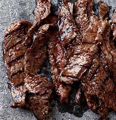 Recipe for Korean Sizzling Beef - This succulent recipe is based on bulgogi, a classic Korean dish of sliced beef that's marinated in soy sauce, sugar, sesame oil and garlic, then grilled.