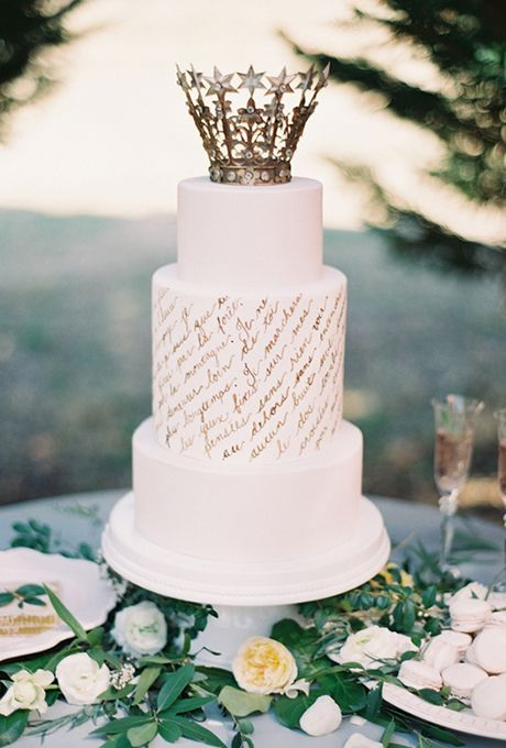 This simple, ethereal confection from Earth & Sugar features verses from a French poem hand-calligraphed in antique gold and topped with a vintage crown