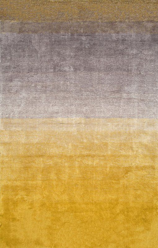 Create a plush landing spot next to your bed or by the home bar with this beautiful hand-tufted polyester rug. While its ombre pattern lends artful dimension and contrast, the yellow color palette keeps it vibrant and harmoniously blends into any contemporary or eclectic aesthetic. Place it in the center of the living room, top it with an iron and glass coffee table, then dress the arrangement with lush plants, mirrored coasters, and glittering candles for a cozy lounge space. For a lighter…
