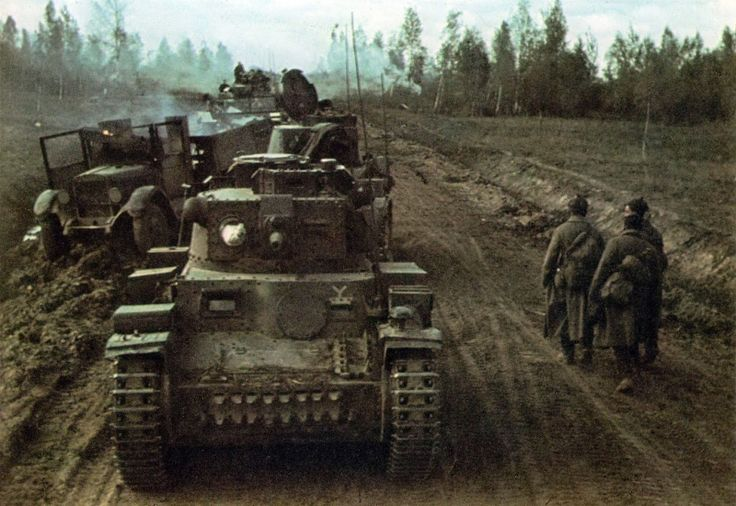 7th Panzer Division (7. Panzer-Division) drives past a burning truck on the side of the Soviet. In the foreground tank Pz.38 (t).