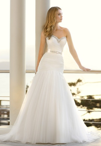 white Mermaid Trumpet Style Wedding dress. love the top - not crazy about the bottom