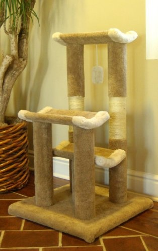 "$126.99-$158.00 This dynamic, durable 45"" Kitty Cat Jungle Gym Cat Tree is covered in designer carpet. The cat furnishing features three lounging platforms for your cat or kittens long afternoon naps. The posts feature sisal rope scratching areas for your cat or kittens clawing pleasure. Also included is a dangling cat toy. This cat scratching post is great for homes with multiple cats. Brand New ..."