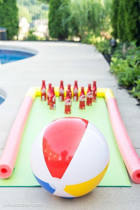 DIY Projects - Outdoor Games - DIY Bowling Game with Coke Bottles a yoga mat - pool noodle bumpers and a beach ball - fun Tutorial via The Polka Dot Chair