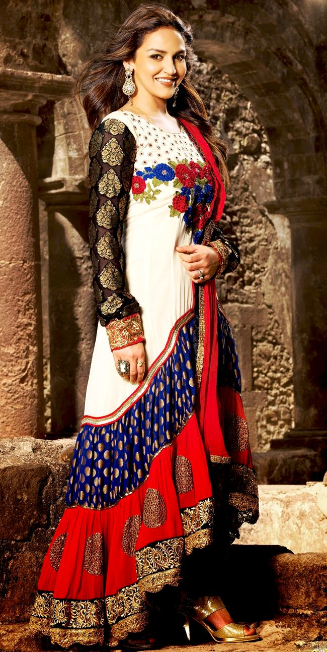 The fascinating beautiful subtly garment with lovely patterns.   The dazzling off white, dark blue and red faux georgette and viscose anarkali churidar suit have amazing embroidery patch work is done with resham, zari, sequins, stone and lace work.   Beautiful embroidery work on kameez is stunning.   The entire ensemble makes an excellent wear.   Matching dark blue santoon churidar and red faux chiffon dupatta is available with this suit.