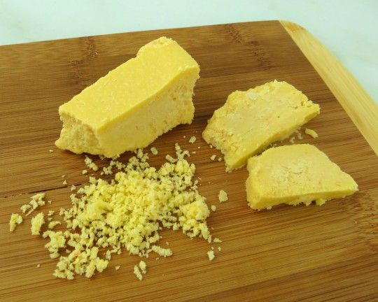I love sharp cheddar cheese! This Paleo-Vegan cheese tastes almost exactly like Wisconsin cheddar, except it's dairy-free. It is a firm, rich, creamy cheese, with a slightly tangy flavor. Delicious on crackers, slice it for sandwiches, grate it into salads and soups, or use it to make vegan cheese sauce for veggies. It is made with coconut butter, lemon and a few other secret ingredients you can find in any healthy grocery. It's easy to make – just blend, chill, slice, and eat!