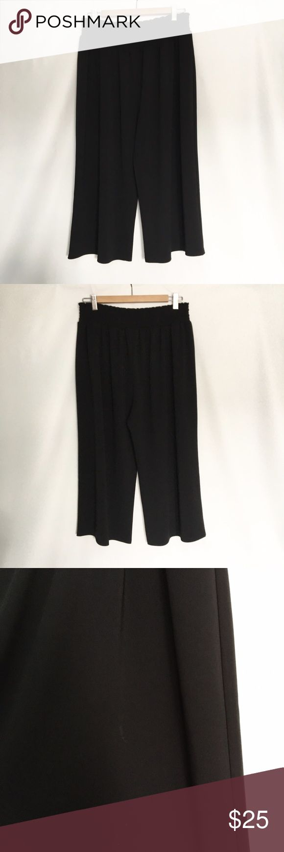 Rafaella Black Culottes Super comfy loose design. Cropped length. As pictured in the last photo. Small area of discoloration on the left pant leg. Rafaella Pants Trousers