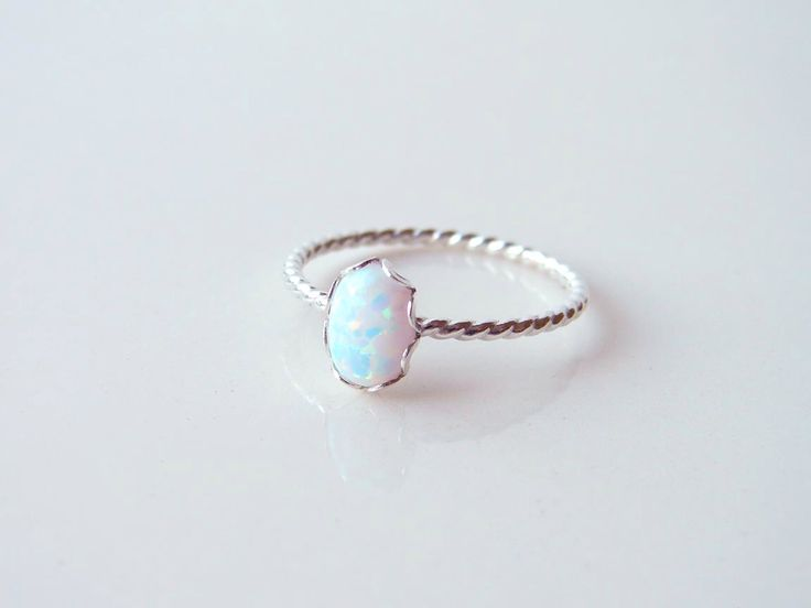 Small Oval Opal Ring. Sterling Silver Twisted Ring. Bridesmaid Gift. October Birthday. Simple Modern Jewelry by PetitBlue by PetitBlue on Etsy https://www.etsy.com/listing/206798074/small-oval-opal-ring-sterling-silver