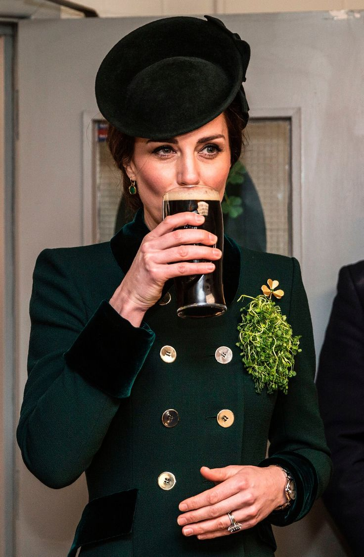 St Patrick's Day 2017: World goes green to celebrate Ireland's patron saint  -      Britain's Catherine, Duchess of Cambridge sips a pint of Guinness as she talks with off-duty soldiers from the 1st Battalion Irish Guards, after watching their annual St Patrick's Day parade at Cavalry Barracks in Hounslow, west London on March 17, 2017. / AFP PHOTO / POOL / RICHARD POHLERICHARD POHLE/AFP/Getty Images  Credit: AFP/Getty Images  Copyright: AFP or licensors