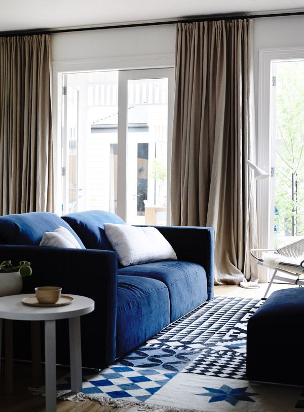Living / TV room – stunning ash blonde timber, neutral linens and royal blue colour palette used to maximum effect throughout the living space.   Interior design by Hecker Guthrie.  Photos - Derek Swalwell, production – Lucy Feagins / The Design Files.