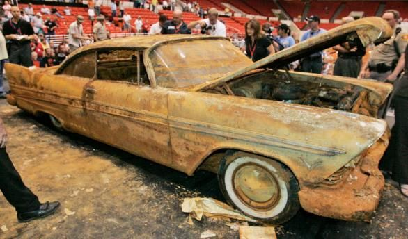 Encased in concrete for 50 Years A 1957 Plymouth Fury 12781406.jpg (586×344)