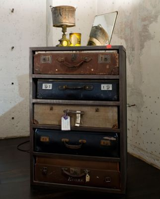 A chest of drawers made from old suitcases.