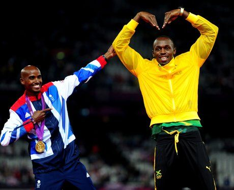 Mo Farah and Usain Bolt exchange their signature poses - the Mobot and Lightning Bolt.