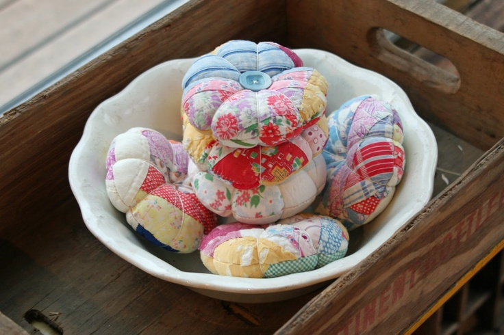 Use pieces of old quilts to make pincushions