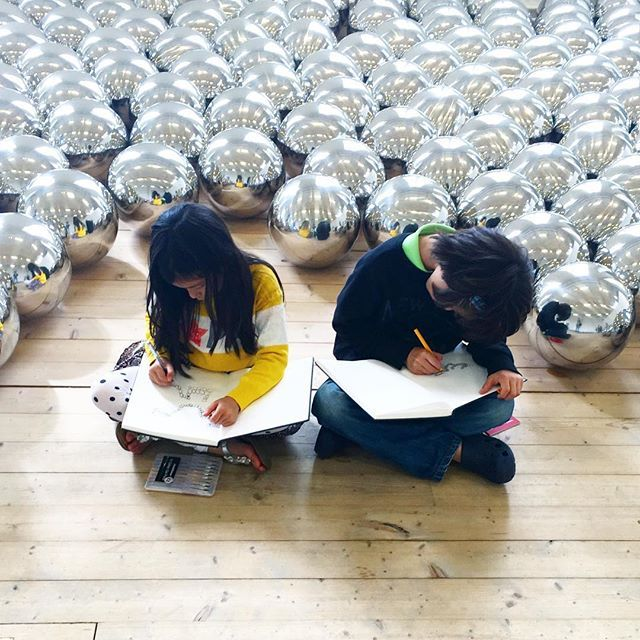Sketching in a room full of silver balls. More about our visit to Moderna Museum…