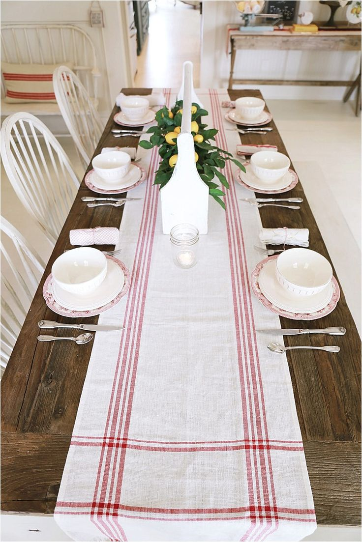 Life On The Shady Grove White Farmhouse Home Tour at Fox Hollow Cottage. Wood farmhouse table with grain-sack runner and Lemon enterpiece