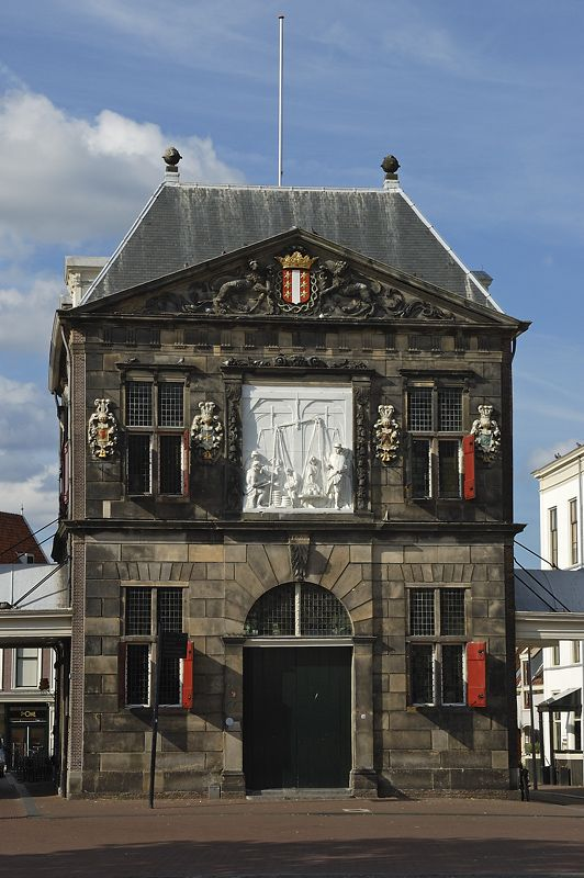 De Weigh House, built in 1668, is a restraines counterpoint to de Town Hall in de Market Square, Gouda, Zuid Holland_ South Netherlands