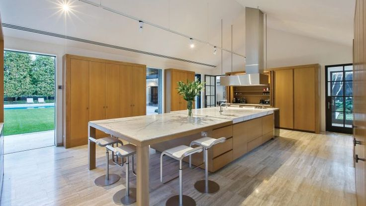 The kitchen sits in the modern wing and has easy access to the gardens.