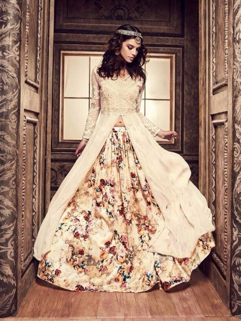 An impressive  Cream Color Printed Lehenga Anarkali Gown Suit and thread work crafted on slits and sleeves. This vibrant suit is paired with dupatta