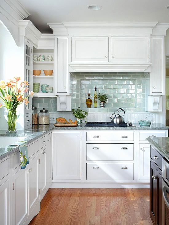 Love the tile backsplash and moulding around the cabinets