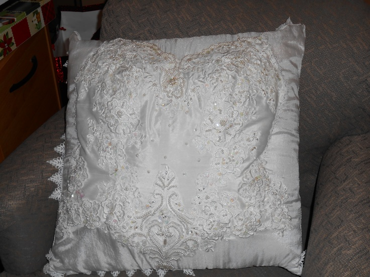 Wedding Dress-  I gave my Mother my wedding gown and told her to use it to make beautiful things that could be admired on a daily basis so it is not just sitting in an attic collecting dust, only to be appreciated when getting down the Christmas ornaments...This is what I recieved this Christmas...cried my eyes out...2 large pillows...1 the front of my dress and1 the back with the buttons...Looooove!!!...& I will be reminded of my Mother's love everyday!!!!