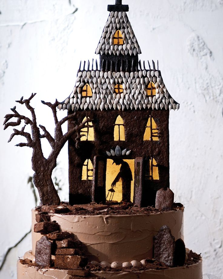 Haunted-House Cake | Martha Stewart Living - You will need to make the Haunted-House Chocolate Cookies to decorate this spooky cake. Plain torrone or nougat can be rolled in cocoa powder and used in place of chocolate torrone. You will also need one 9-inch and one 11-inch round foam board, 11 round wooden dowels (1/4-inch diameter each), and toothpicks for this recipe.