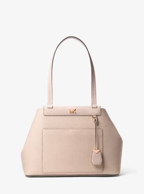 7df769b26f5b Crafted from pebbled leather, this Meredith tote features polished hardware  and has side gussets that
