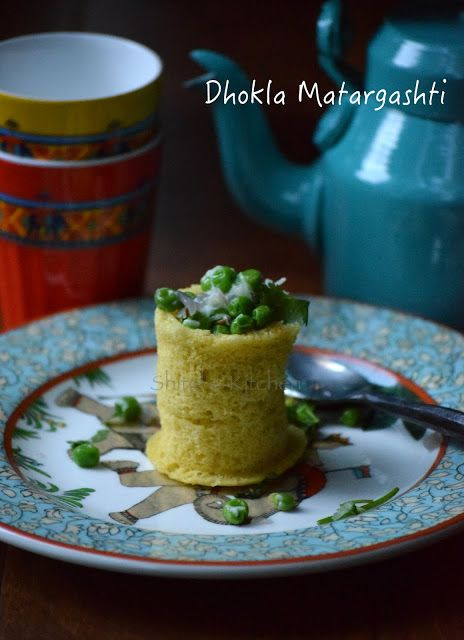 Dhokla made in shot glasses and stuffed with green pea filling.
