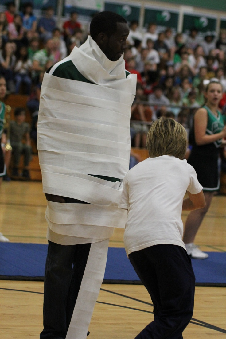 "the pep rally games-""wrap up the wolves"" Possible pep rally idea before homecoming. Have a competition in which students wrap up a couple teachers and have the teachers race once they are restrained."