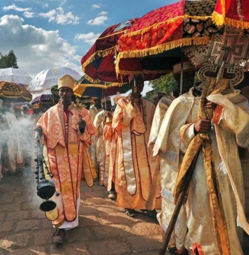 Ethiopian priests and monks walk during the annual festival of Timkat in Lalibela, Ethiopia. The festival celebrates the Baptism of Jesus in the Jordan River.