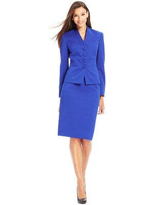 le suit four button textured skirt suit show clothes