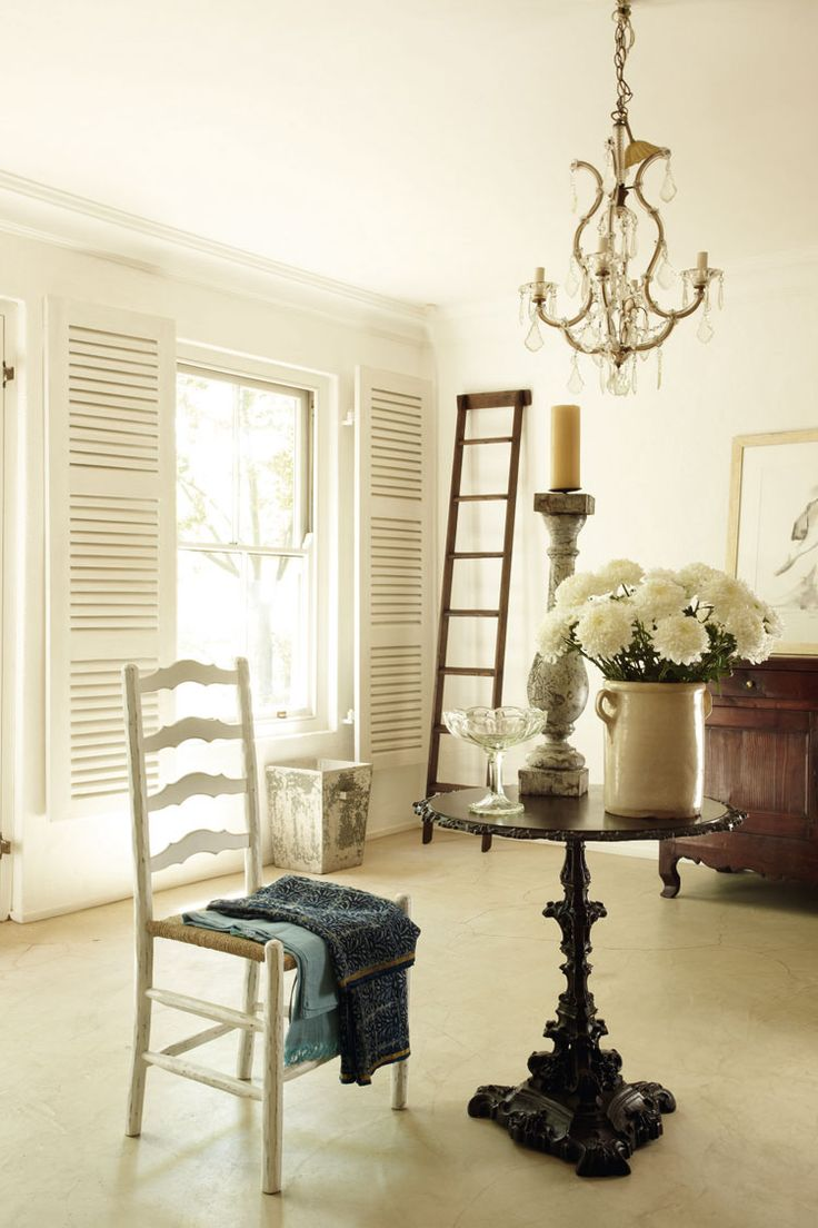 White shutters and a simple screed floor create just the right canvas for collected treasures