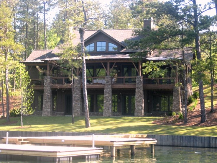 Lake house plan by l mitchell ginn associates arched for Lake front house plans