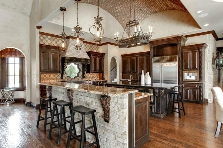 The Different Shapes of Large Kitchen Island Designs for Traditional Interior Medieval Round Wrought Iron Chandelier With Decorative Stone Kitchen Island Design For Italian Kitchen Plan With Unique Ceiling