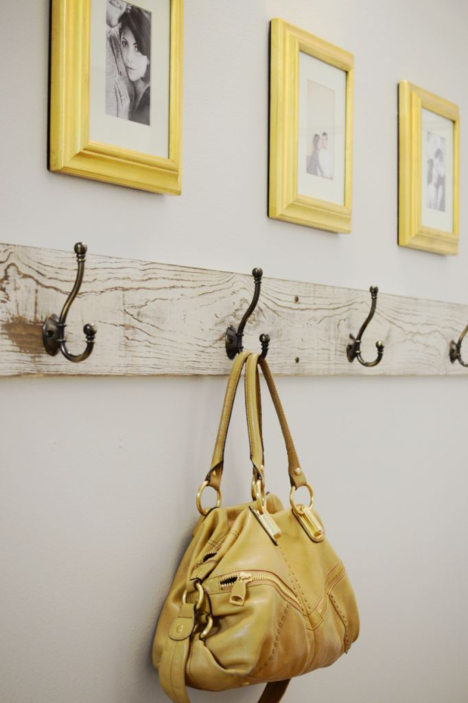 entryway. I've pinned this idea before but I like the bright colored frames above the hooks in this one
