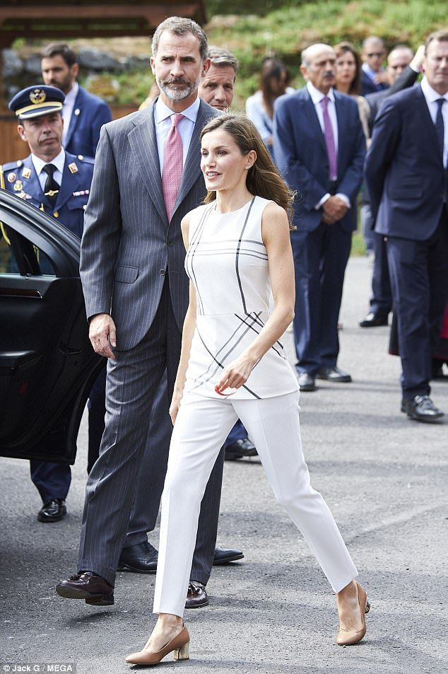 Queen of thrift! Letizia, 44, showed off her toned arms to perfection in the £220 sleeveless Lamma checked top which she was first spotted in last year