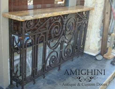 Unique and vintage, this console table features an antique, wrought iron balcony piece and a natural edge granite top that the natural beauty of the stone.  #vintage #repurposed #amighini