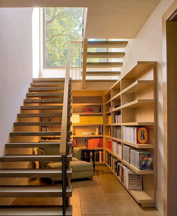 Space-under-the-staircase-is-used-as-a-reading-nook