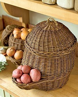 Keep Your Potatoes and Onions in Old World Vegetable Baskets   Plastic grocery bags retain moisture, speeding the demise of potatoes and onions. These breathable woven baskets, used for centuries in Europe, are a better solution. They fill from the top, and dispense vegetables from the pocket below....genius!