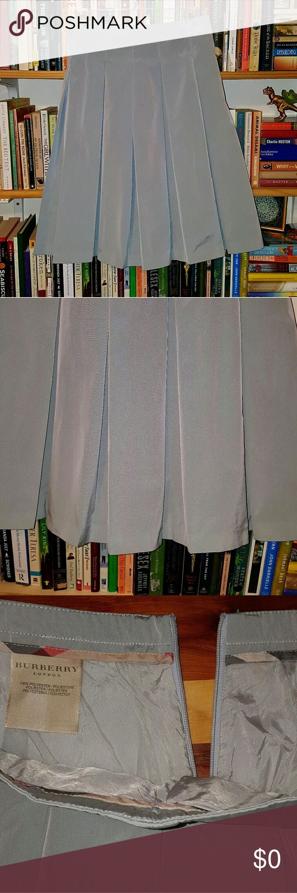 Rare Burberry Box Pleat Skirt Beautiful Burberry skirt that's a stiff, shiny gray/silver polyester (taffeta? I'm bad with fabrics) and cupro lined. Box pleated and zipper in the back. Lightly worn with no defects. Burberry Skirts