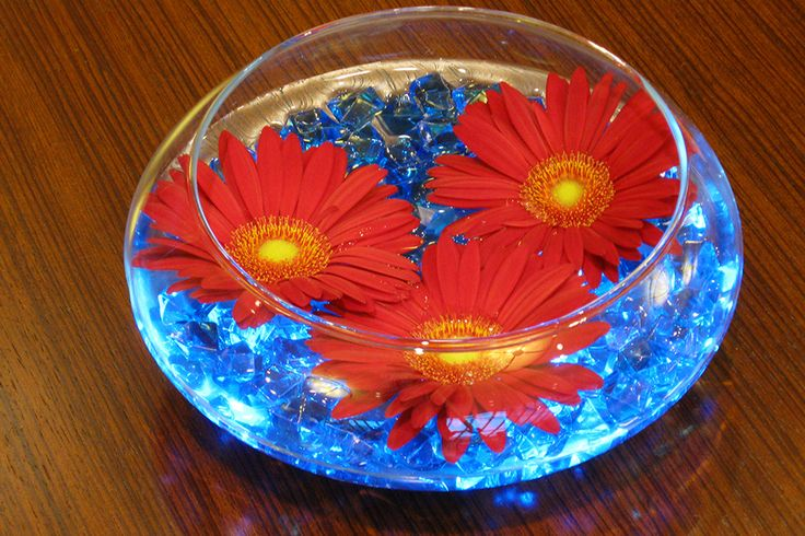 Glass Bowl with Blue Crystal Chips  Floating Orange Gerber Daisies