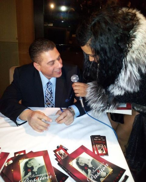 Valentinno's book signing event at Trump World Towers. Styled by: Shirley Jusino, Calvin Klein suit, dress shirt, tie, & shoes. Follow Valentinno on twitter: @poetvalentinno