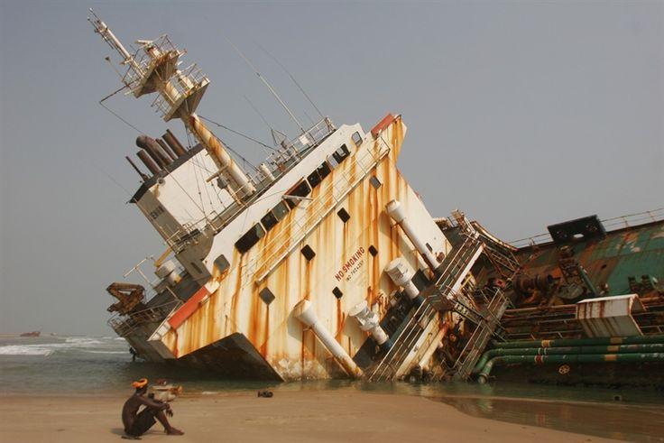 Large abandoned ships rust on Nigerian beach - Photos