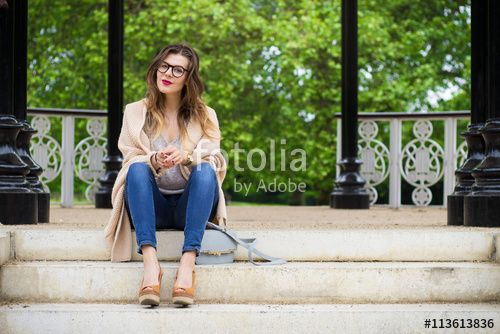 Attractive woman sitting on the stairs in the park
