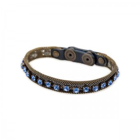 Bracelet In nickle mesh with a row of glitter rhinestones and tone on tone leather fastening with snap button.
