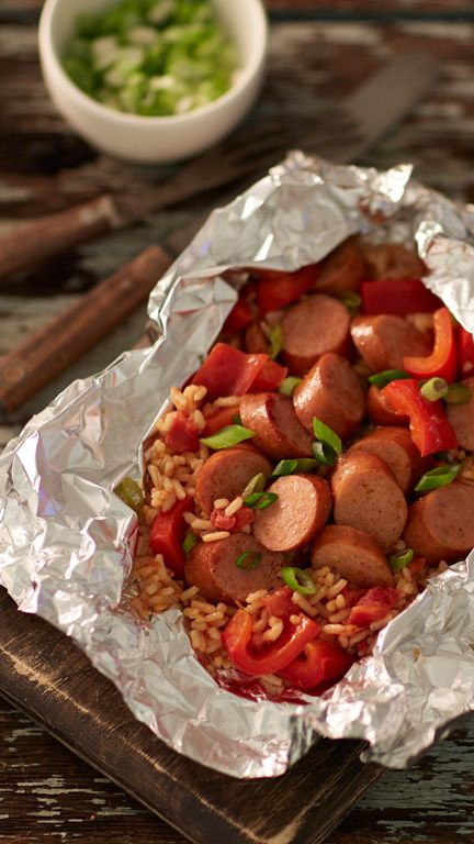 Sure to be a crowd-pleaser, these foil packs are loaded with kielbasa, bell peppers and Cajun-spiced rice with just enough heat to keep things interesting. To make in oven, place packs on cookie sheet and bake at 375°F 18 to 20 minutes or until sausage is heated through and peppers are crisp-tender.