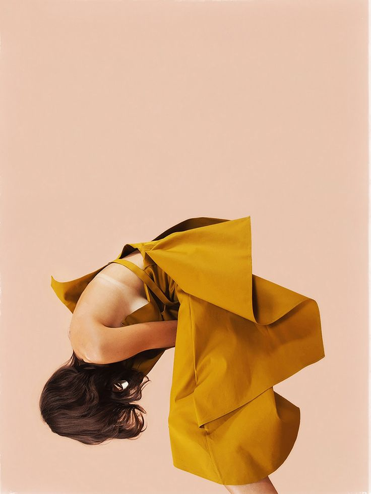 photo of a woman in a mustard dress