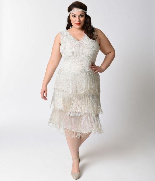 Nobody takes Gigi for granted, dames! This exquisite white chiffon plus size flapper dress is a Unique Vintage original, hand beaded with ornate…