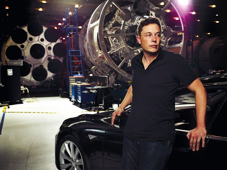 elon with his model s at spacex for more visit www evannex