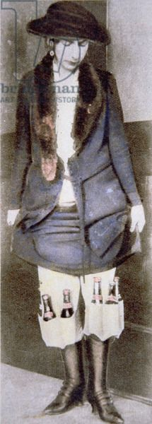 A woman hiding illegal bottles of beer under her skirt in special underwear pockets during the American Prohibition (1920-33) (coloured photo)